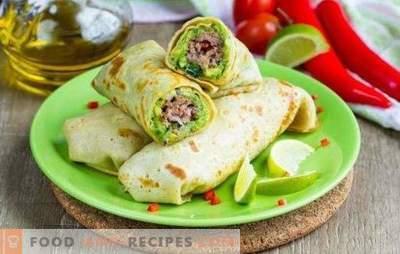 Pain Lavash avec de la viande hachée cuite au four - un plat consistant. Faire cuire au four un pain pita avec de la viande hachée, des légumes, du fromage