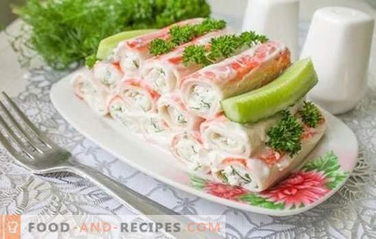 L'apéritif des bâtons de crabe est un plat savoureux à base de produit diététique. Les meilleures recettes pour les collations chaudes et froides à partir de bâtonnets de crabe