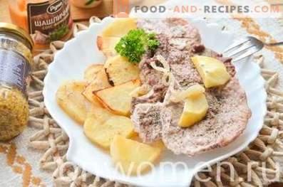 Porc sur un coussin de pommes de terre au four