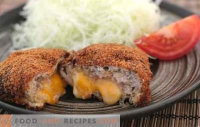 Les côtelettes de viande et de fromage hachées sont un ajout délicat à un plat d'accompagnement crémeux. Côtelettes de viande hachées avec du fromage à l'intérieur